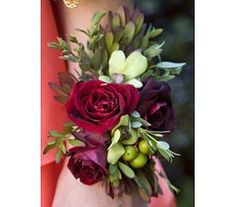 Red Sweetheart Roses, Hypericum Berry, and Green Orchid Wristlet or Corsage