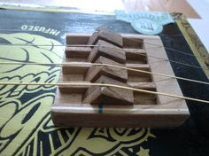 4-string w/ Tunable bridge http://www.cigarboxnation.com/profiles/blogs/have-built-a-new-4stringer-cbg