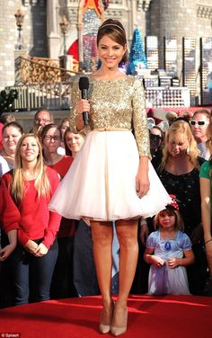 Magical: Maria sparkled in a two-part dress that featured a gold sequin top and flowing chiffon mini skirt