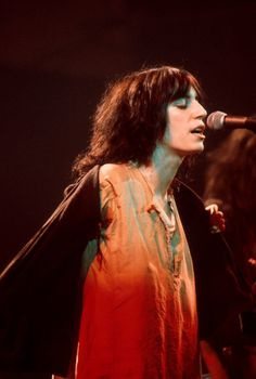Patti Smith performs on stage, New York, 1976.