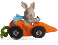 What a lovely Bunny! What a cute Car-Rot!  Fittipaldi is so cute and so pretty....  This lovely bunny is going to the race cars with his wonderful Car-Rot!  He is wearing a lovely knitted runners in royal blue color, sweet knitted turquoise scarf and lovely knitted bright orange Car-Rot with felt number 8 detail, the wheels are knitted and the centers are sewing machine's spools.  Bunny Tall size from top ear to toe 6.29 inches – 16 cm and designed for adorable sand color wool yarn.  This…