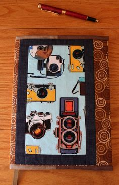 Quilted Fabric Journal Cover Vintage Cameras Brown and Blue. CandyKQuilts on Etsy. Love!
