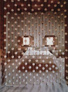 Ping pong balls used to make this cool curtain/ room divider