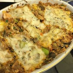 Tuna Bake It's the goodness of a tuna melt with a different kind of crunch (gluten free). Sautéed: 1/2 onion 3 cloves garlic 3-5 celery sticks (chopped small) 3 carrots chopped small) Olive oil Add to that in a baking dish: 3 cans tuna 1/2 or so tomato sauce 1/2-1 cup of mozzarella shredded cheese 1 tsp chopped fresh parsley 1 tsp fresh black pepper 3-4 slices Munster cheese on top Bake @ 350•F for 20-30 min.