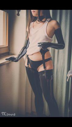 Black latex stockings suspenders opera gloves and panties