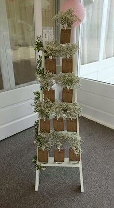 Step ladder seating plan with gypsophila - beautiful! Wedding