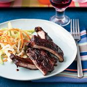 Apple-Glazed Barbecued Baby Back Ribs - These sticky, apple-scented ribs are cooked in the oven, then finished on the grill.