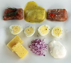 Three types of pickled herring on a plate