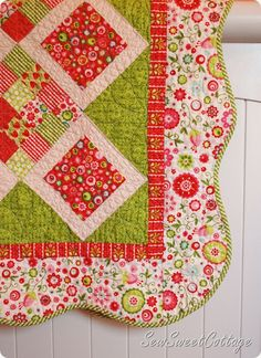 Love the scalloped edge and that border floral fabric.  And the colors.  Okay I just love it all. :)