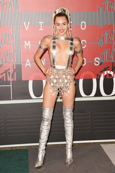Miley Cyrus shows a lot of skin in custom Versace