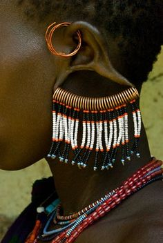 Bernadette Ojo - Details of the jewellery worn by a Surma - Omo Valley – Ethiopia - África – em- A unique design that may be seen by the Olinkas, in The Color Purple. African Jewelry, Tribal Jewelry, Tribal Earrings, Ear Jewelry, Jewellery, African Tribes, African Art, African Beauty, African Fashion