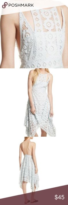 Free People Lace Asymmetrical Dress Sultry and lady-like, this lace dress by Free People is just what your fabulous closet has been missing. Be the most fashion-forward guest at your next special event when you complete this look with sky-high heels and dazzling jewels. Be the talk of the town when you step out in sleek style with this gorgeous must-have. Color: Sky, pale blue Zip closure Halter neck Sleeveless Fully lined Hand wash Free People Dresses Midi