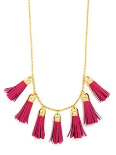 These petite leather tassels add luxe texture to your look with an unexpected pop of color and gold hardware.