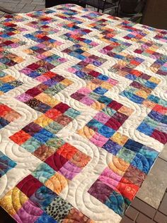 I am not starting this project right away....but thought I would share my sleuthing on this.   This pin is all over Pinterest....with no info or original source.  It is bright and colorful, yet the