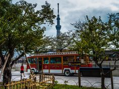 Asakusa Geta Dance Festival 10/10 A touring bus looking like a San Fransisco cable car and advertising its services with the Tokyo Sky Tree in the background. It was s a little surreal but the old-fashioned touch is certainly appreciated! (It was also featured in the Sambo Carnival back in August http://www.pinterest.com/pin/196047390004246740/) #Asakusa, #Hanakawado, #Sumidakoen, #geta, #festival, #bus October 12, 2014 © Grigoris A. Miliaresis