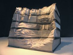 Guy Laramee book sculpting. I like to imagine this is the facade of an ancient library.