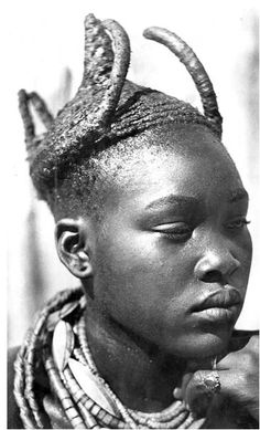 Namibia/Southern Angola:  Married OvaWambo woman wearing the omhatela-headdress, c. 1940  Photo by: A. Scherz