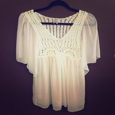 Max Rave White Short Sleeve Shirt! Max Rave White Short Sleeve Shirt. Crochet Design on top Front & Back. Has Sheer Flowing Sleeves and Bottom. 100% Polyester, Made in China. Great Condition! Max Rave Tops Blouses