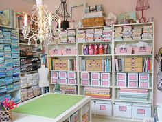 Organised bins bookcases in a sewing studio