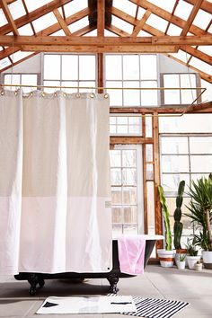 Statement Shower Curtains from Quiet Town (Plus Glamorous Hooks) (Remodelista: Sourcebook for the Considered Home) Two Shower Curtains, Elegant Shower Curtains, Shower Curtain Hooks, Bathroom Trends 2017, Loft House, House Studio, Canvas Curtains, Bathroom Images, Modern Bathroom