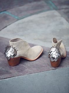 Silver Diamond Ankle Boot | Western-inspired slip-on ankle boots in a luxe suede featuring statement metal accents and metal stud detailing. Rounded toe and stacked heel.