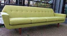 Long Danish 1960's sofa in lime green linen.