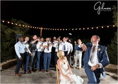 Garter Toss | bride & groom, groomsmen, string lights, blue suit, white wedding dress, white dress shirts, Secluded Garden Estate, Temecula, Inland Empire, Riverside County, Newport Beach, Orange County, Southern California, wedding photographer | Gilmore Studios | gilmorestudios.com