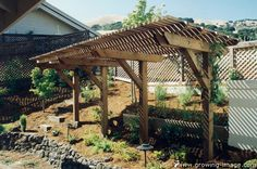 Cantilevered Trellis with Sonoma Fieldstone rock wall — Lucas Valley, CA