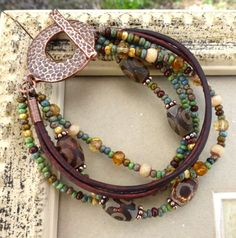 Czech glass, glass seed beads, agate stone, leather and copper metal bracelet.