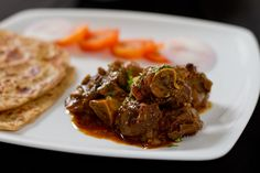 This easy to make Punjabi style mutton curry is extremely flavourful and can be made in a jiffy. Serve it with square layered parathas.