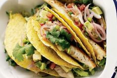 Serve the seared spicy fish in crisp taco shells with piles of lettuce and an avocado, tomato and jalapeño salsa.