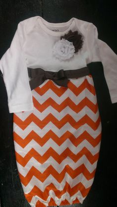 This fantastic orange chevron gown with brown accent ribbon and flowers is a perfect newborn baby gown for Thanksgiving. Similar to the popular