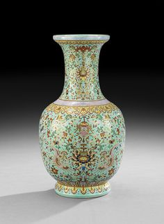 "Chinese Turquoise-Ground Porcelain Vase the ovoid body with slightly squared shoulders on a raised and rounded foot with lappet motif, enameled in a vibrant famille rose palette with gilt accents, the underside with a blue Daoguang reign mark (1821-1850) and probably of the period, h. 13-1/4"", dia. 7""."