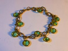 Peridot glass rhinestone bracelet   7 1/2 inch gold tone chain  secures with spring clasp by GemstoneCowboy on Etsy