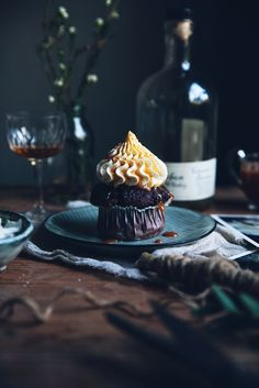 Double chocolate banana muffins with mascarpone frosting and bourbon caramel sauce