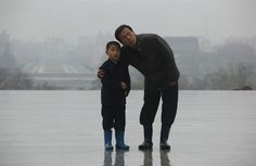 A North Korean father and his son look at the statues of late leaders Kim Il Sung and Kim Jong Il after they paid tribute during a holiday in honor of the 80th anniversary of the founding of the North Korean Army in Pyongyang, North Korea, April 25.