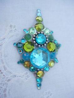 Incredible bindi.. https://www.etsy.com/listing/172917828/peacock-crystal-bindi-swarovski-tribal?ref=favs_view_8