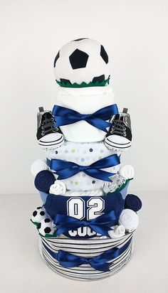 Nappy Cake for Baby Showers, Maternity Farewells or a Gift for the New Arrival! Delivering to Brisbane, Sydney, Melbourne & Baby Shower Nappy Cake, Baby Nappy Cakes, Cadeau Baby Shower, Torta Baby Shower, Diaper Cake Boy, Baby Shower Gifts, Baby Cakes, Diaper Cakes, Baby Boy Soccer