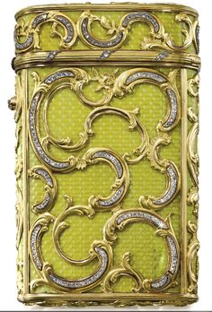 A Fabergé Imperial enamel cigarette case with jewelled two-colour gold mounts, workmaster Michael Perchin, St Petersburg, 1899. in rococo taste, the surface enamelled in translucent chartreuse yellow over banded wavy engine-turning, overlaid with diamond-