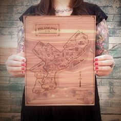 Neighborwoods project was created by designer Aymie Spitzer;  hand-drawn and labeled maps, pendants, and coasters