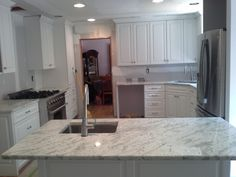 Kitchen, Awesome Minimalist Kitchen Design With An Electric Refrigerator And High Gloss Finish White Granite Countertops Also A Couple Of Sink And Washbasin White Wooden Kitchen Cabinet: Awesome Uniquely Kitchen Cabinet Styles