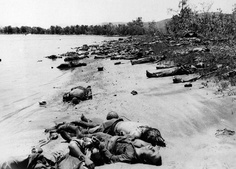 23 Dead Japanese soldiers cover the beach at Tanapag, on Saipan Island, in the Marianas, on July 14, 1944, after their last desperate attack on the U.S. Marines who invaded the Japanese stronghold in the Pacific. An estimated 1,300 Japanese were killed by the Marines in this operation. (AP Photo) #