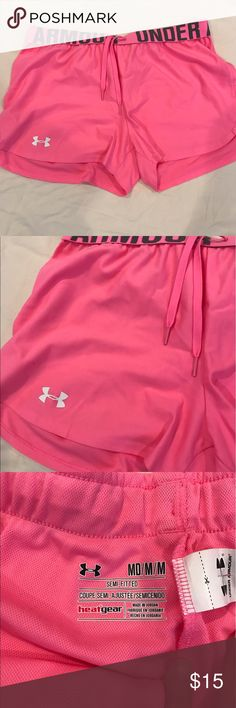 Bright pink Under Armour shorts Bright pink athletic Under Armour shorts. Worn once. Never dried-- hang dry all clothes. Same or next day shipping. ▫️MAKE AN OFFER▫️ Under Armour Shorts