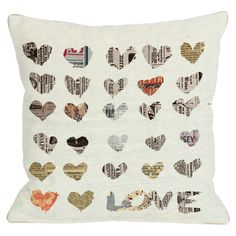 Pillow with a newsprint hearts motif. Made in the USA.  Product: PillowConstruction Material: Polyester cover an...