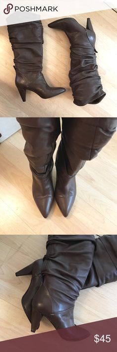 Tall slouchy genuine leather boots Super soft genuine leather boots by Hugo boss. Great condition, only wore it once. Size 37. Slouchy style, perfect with leggings. Hugo Boss Shoes Heeled Boots