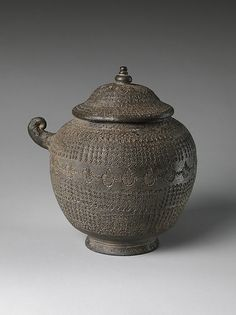 Covered urn with geometric decoration Period: South and North Kingdoms period (668–935), Unified Silla Date: 8th century Culture: Korea Medium: Stoneware with stamped design