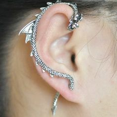 The earring is a fake gauge! You do not need to have gauged ears to wear them, only simple pierced ears.  Listing is for ONE earring, because they are traditionally worn as a piece, not in a pair. If you would like TWO earrings, please message me. Eligible for discount.  For the right ear. S...