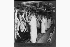 """violent crimes higher amongst slaughterhouse communiites. the pic is Meat inspectors in a Chicago plant in 1906. Upton Sinclair's landmark novel """"The Jungle"""" detailed the inhuman conditions in turn-of-century U.S. abattoirs. It also inspired a contemporary study of the links between slaughterhouses and rates of violent and sexual crimes in adjacent communities."""
