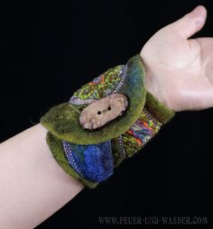 Individual nuno felted merino wool and colorful viscose fabric cuff of paisley designs. green and saturated blue by FeuerundWasser on Etsy