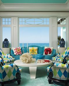 Love this room...the harlequin print on the victorian chairs, the gorgeous use of blue and green, and that ceiling!